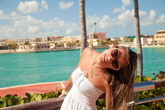 Young attractive woman near the Caribbean sea on a summer day Royalty Free Stock Photos