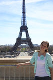 Young attractive woman near Eiffel Tower. stock image