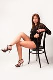 Pretty brunette girl on chair Royalty Free Stock Photography