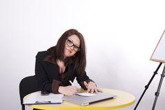 Young attractive woman at the office Stock Image