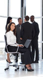 Young attractive woman in office working Royalty Free Stock Photos