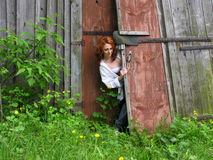 Young attractive woman in the old abandoned farm Royalty Free Stock Image