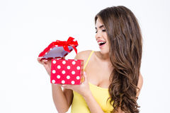Young attractive woman opening present box Royalty Free Stock Photo