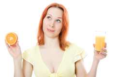 Young attractive woman with oranges and juice. In her hands Stock Photos