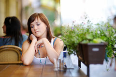 Young attractive woman in outdoor cafe Royalty Free Stock Photo