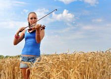 Young attractive woman playing the violin Stock Photos