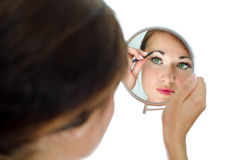 Young attractive woman plucking her eyebrows Stock Images