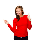 Woman pointing isolated on white background Royalty Free Stock Images