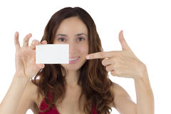 Young attractive woman pointing to a blank business card Stock Images