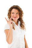 Woman pointing  on white background Royalty Free Stock Image