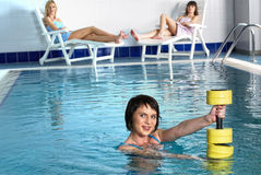 Young attractive woman in pool doing exercise Stock Photo