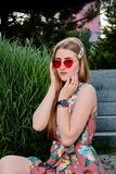 Young attractive woman. Red sunglasses, color dress. Young woman portrait. stock images