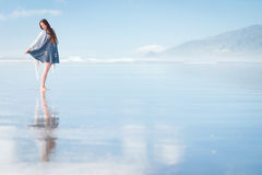 Young attractive woman posing at amazing New Zealand beach Stock Photo