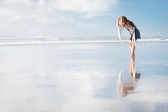 Young attractive woman posing at amazing New Zealand beach Royalty Free Stock Images