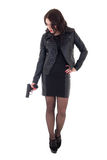 Young attractive woman posing with gun isolated on white Royalty Free Stock Images