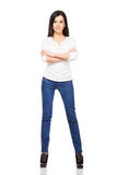 Young and attractive woman posing in jeans Royalty Free Stock Photos
