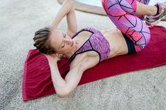 Young attractive woman practicing abdominal, working out royalty free stock photography