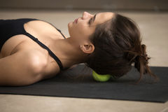 Young attractive woman practicing self-massage technique with te Stock Images