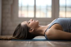 Young attractive woman practicing yoga, doing Dead Body, close u. Young sporty attractive woman practicing yoga, doing Dead Body, Savasana exercise, Corpse pose stock images