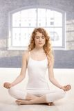 Young attractive woman practicing yoga meditating Royalty Free Stock Photos