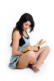 Young attractive woman  reading a book Stock Photo