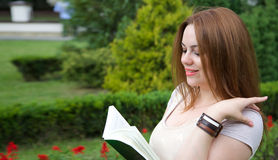 A young attractive woman is reading a book Royalty Free Stock Photo