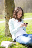 Young attractive woman realxing at the park Stock Image