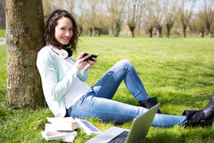 Young attractive woman realxing at the park Stock Images