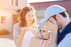 Young attractive woman receiving parcel at home Stock Photo