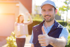 Young attractive woman receiving parcel at home royalty free stock image