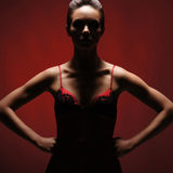 A young and attractive woman in a red erotic dress Stock Images