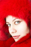 Young attractive woman in red fur-cap Stock Image