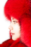 Young attractive woman in red fur-cap Stock Images