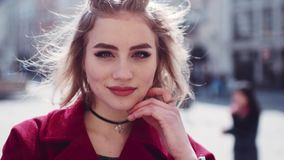 Young attractive woman with red lips and playful smile. Beauty, gorgeous woman. Modern females. Sunny weather, blue eyes stock footage