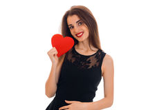 Young attractive woman with red lips preparing to celebrate valentines day with heart symbol in studio isolated on white Stock Image