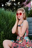 Young attractive woman. Red sunglasses, color dress. Young woman portrait. royalty free stock images