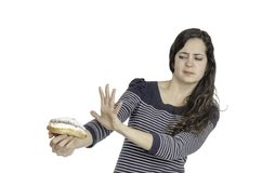 Young attractive woman refuse a cream cake. Stock Photography