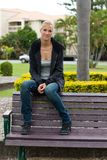 Young attractive woman relax in the park Stock Photos