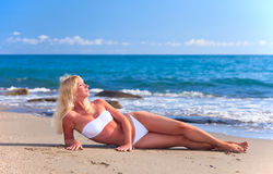 Young attractive woman relaxing on Stock Photography