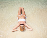 Young attractive woman relaxing on the beach. Stock Image