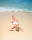 Young attractive woman relaxing on the beach. Stock Photography