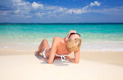 Young attractive woman relaxing on the beach. Royalty Free Stock Photos