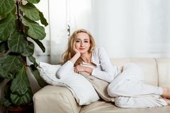 Young attractive woman relaxing at home Royalty Free Stock Photography