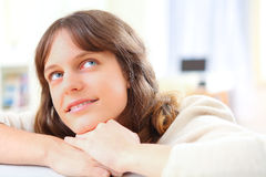 young attractive woman relaxing on sofa Royalty Free Stock Photos