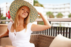 Young attractive woman on a resort royalty free stock photography