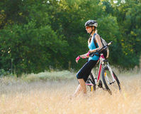 Young Attractive Woman Resting with Bike in the Beautiful Forest Stock Photos