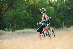 Young Attractive Woman Resting with Bike in the Beautiful Forest Royalty Free Stock Images