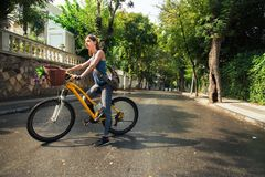 Young attractive woman riding a bicycle. Royalty Free Stock Photo