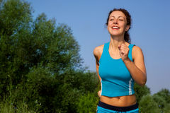 Young attractive woman runs in the country Stock Photo