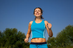Young attractive woman runs in the country Royalty Free Stock Image